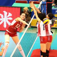 Attack mode: Russia's Alexandra Pasynkova spikes the ball against Japan during Tuesday's match in Nagoya | FIVB