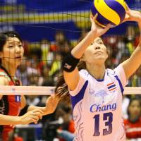Time for a lift: Thailand's Nootsara Tomkom sets the ball against Japan in their FIVB Women's Grand Champions Cup match on Friday | FIVB
