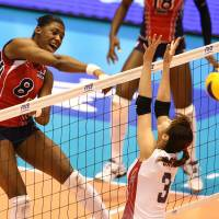 A show of strength: The Dominican Republic's Candida Arias Perez hits the ball against Japan on Saturday | FIVB