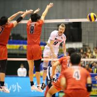 Finding a way: Italy's Ivan Zaytsev hits a spike past Japan's defense on Saturday. | FIVB
