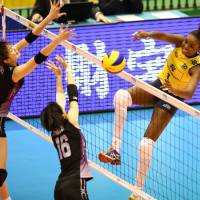 Unstoppable: Brazil's Fabiana Claudino spikes the ball during her team's straight-sets win over Japan in Tokyo on Sunday | FIVB
