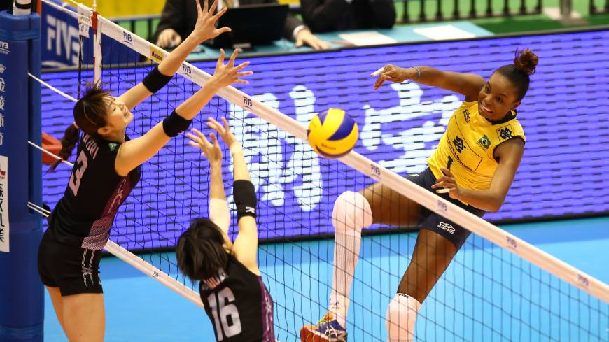 Unstoppable: Brazil's Fabiana Claudino spikes the ball during her team's straight-sets win over Japan in Tokyo on Sunday