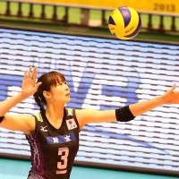 Strike force: Japan's Saori Kimura prepares to serve during Sunday's World Grand Champions Cup match against Brazil | FIVB