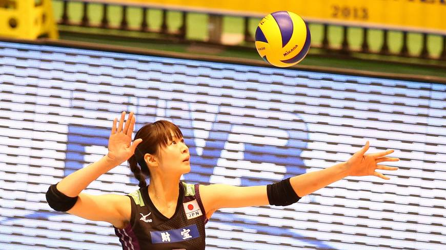 Strike force: Japan's Saori Kimura prepares to serve during Sunday's World Grand Champions Cup match against Brazil