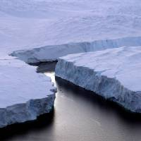 Cracking: An enormous iceberg (right) breaks off the Knox Coast in the Australian Antarctic Territory in January 2008. The World Meteorological Organization, the U.N. weather agency, said Wednesday in Geneva that concentrations of carbon dioxide in the atmosphere have accelerated and reached a record high in 2012 | AFP-JIJI
