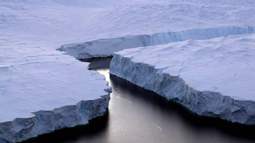 Cracking: An enormous iceberg (right) breaks off the Knox Coast in the Australian Antarctic Territory in January 2008. The World Meteorological Organization, the U.N. weather agency, said Wednesday in Geneva that concentrations of carbon dioxide in the atmosphere have accelerated and reached a record high in 2012