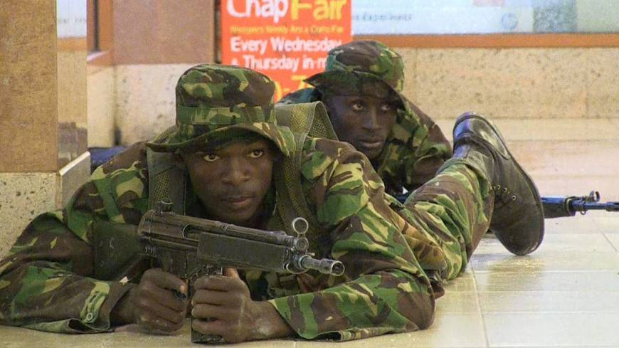 Down low: Kenyan troops take up positions inside Nairobi's Westgate Mall on Sept. 21 after Somali militants attacked the upscale shopping complex.