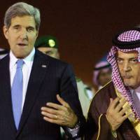 Important allies: U.S. Secretary of State John Kerry is welcomed by Saudi Foreign Minister Prince Saud al-Faisal following his arrival in Riyadh on Sunday. | AFP-JIJI