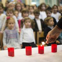 Life lesson: Candles are lit at the Or Avner Jewish school in Berlin that Israel's chief rabbi visited Friday to speak to students about the Kristallnacht (Night of Broken Glass) Nazi pogrom in November 1938, as events got underway to mark the 75th anniversary of the attacks. On Nov. 9-10, 1938, Nazi thugs plundered Jewish businesses throughout Germany, torched synagogues and rounded up about 30,000 Jewish men for deportation to concentration camps. | AFP-JIJI