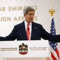 Hopeful: U.S. Secretary of State John Kerry holds a news conference in Abu Dhabi on Monday to brief the United Arab Emirates on efforts to hold Syria peace negotiations and talks with Iran. | AFP-JIJI