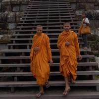Flash point: Cambodian Buddhist monks walk at Preah Vihear temple near the Cambodia-Thailand border in Preah Vihear province on Sunday | AFP-JIJI