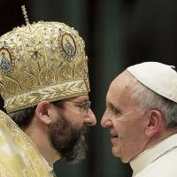 Pope Francis meets the head of Ukraine's Greek Catholic Church at the Vatican on Monday. Francis launched an attack on unfettered markets and trickle-down economics Tuesday, decrying an 'idolatry of money.' Story: Page 7 | AP