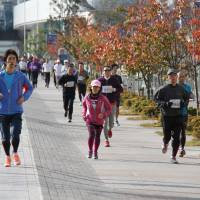 On the run: Participants in the Jogging Matsuri enjoy a lap round Yokohama Minato Mirai Sports Park.