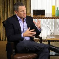Come clean: Lance Armstrong talks to Oprah Winfrey during an interview where the disgraced cyclist gave into years of allegations and admitted that he used performance-enhancing drugs during each of his seven Tour de France wins. | AFP-JIJI