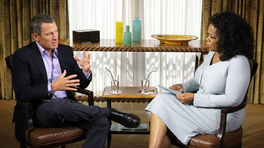 Come clean: Lance Armstrong talks to Oprah Winfrey during an interview where the disgraced cyclist gave into years of allegations and admitted that he used performance-enhancing drugs during each of his seven Tour de France wins.