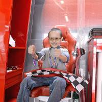 Boy racer: Seventeen-year-old Mostafa Horie spent some time in the Ferrari camp at the Suzuka racing circuit, Mie Prefecture, in October. | COURTESY OF THE HORIE FAMILY
