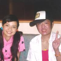 Positive vibes: Yuta Suzuki poses for a photo with TV star Becky during a visit to a TV studio in Tokyo in 2006 that was organized by Make-a-Wish of Japan. | COURTESY OF YUTA SUZUKI