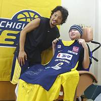 From top: Basketball star Yuta Tabuse grants a fan's wish at a practice sessions; a boy poses for a photo with a conductor after taking a tour of the Doctor Yellow high-speed test train; a 'One Piece' fan is all smiles after receiving toys and a trademark hat. | COURTESY OF MAKE-A-WISH OF JAPAN