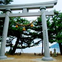 Sacred sands: The great stone torii that stands proud  along with stone lanterns and some of the 500 pine trees on Katsuragahama Beach. | ANGELES MARIN CABELLO