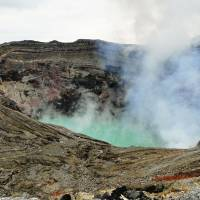 Mount Aso's active Nakadake crater with its bright-turquoise volcanic lake. | MANDY BARTOK PHOTO