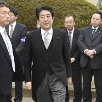 Prime Minister Shinzo Abe arrives at Yasukuni Shrine Thursday morning.  | KYODO