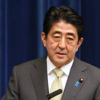 Sticking to the script: Prime Minister Shinzo Abe attends a news conference Dec. 9 in Tokyo. | BLOOMBERG