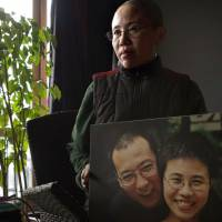 China rushes to try activists during Western holidays