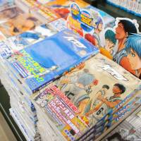 Best-seller: Copies of the popular comic book series 'Kuroko no Basuke' ('The Basketball which Kuroko Plays') by Tadatoshi Fujimaki are seen in a Tokyo bookstore in November. | KYODO