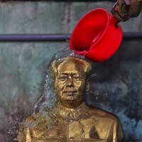 Little red bucket: A statue of Mao Zedong is cleaned at a Shaoshan factory specializing in his images Dec. 5. | AP