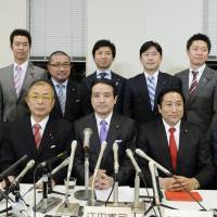 United front: Former Your Party Secretary-General Kenji Eda (seated, center) poses Monday with other lawmakers who left the party. | KYODO