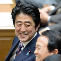 Chuckles:Prime Minister Shinzo Abe chats Thursday with Vice Prime Minister and Finance Minister Taro Aso in the Diet. | AFP-JIJI