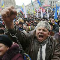 Let it on out: A man shouts slogans during a rally organized by supporters of EU integration on Kiev's Independence Square on Sunday. | REUTERS/KYODO