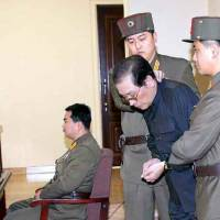 Purged: This shot released Friday by Yonhap News Agency shows Jang Song Thaek, North Korea's No. 2 official, being escorted in a military court Thursday. He was executed the same day.   | AFP-JIJI