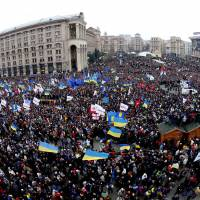 Critical mass: Demonstrators gather during a rally in downtown Kiev on Sunday. As many as 300,000 demonstrators rallied in the center of Ukraine's capital in the biggest show of anger over the president's refusal to sign an agreement with the European Union. | AP
