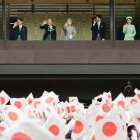 Doing the wave: Emperor Akihito, Empress Michiko and other members of the Imperial family acknowledge well-wishers from the balcony of the Imperial Palace in Chiyoda Ward, Tokyo, to mark the Emperor's 80th birthday on Monday. | KYODO