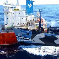 Jaws of activism: The Sea Shepherd vessel Bob Barker hits a Japanese ship as whalers and activists clash in Antarctic waters in February. | INSTITUTE OF CETACEAN RESEARCH/AFP-JIJI