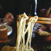 Hearty meal: Soba noodles with a beer are a favorite of Japanese salarymen.