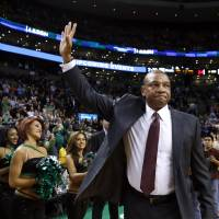 Good to see you: Los Angeles head coach Doc Rivers waves to fans at Boston's TD Garden before the Clippers' 96-88 win over the Celtics on Wednesday. | AP