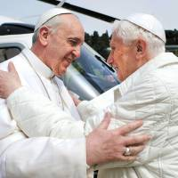 Cut from the same cloth: Pope Francis (left) meets his predecessor, Benedict XVI, at Castel Gandolfo, Italy, on March 23. | AP