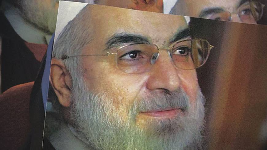 Face of change?: Women hold up posters of Iranian presidential candidate Hassan Rouhani during a campaign rally in Tehran on May 30. Rouhani cruised to victory in the June election.