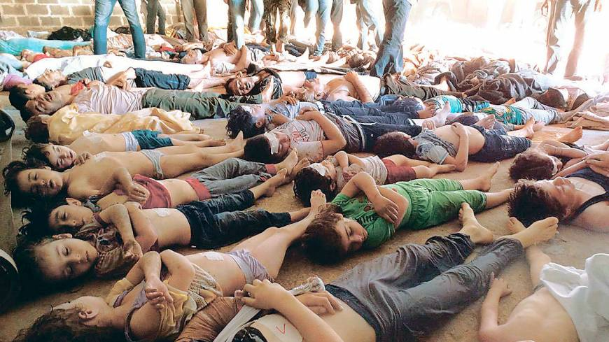 Syrian war: Bodies of children and adults allegedly killed in a chemical weapons attack by pro-government forces are laid out in eastern Ghouta, on the outskirts of Damascus, on Aug. 21.