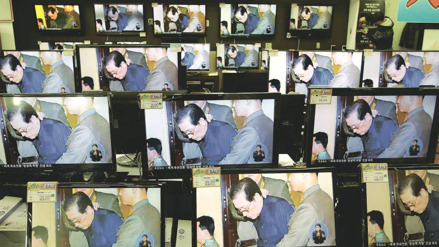 Purged: Monitors at an electronics store in Seoul on Dec. 13 show news about the execution of Jang Song Thaek, the uncle of North Korean leader Kim Jong Un. Pyongyang called Jang a traitor who tried to seize power, a stunning end for Kim's former mentor, who had long been considered the country's No. 2 official.
