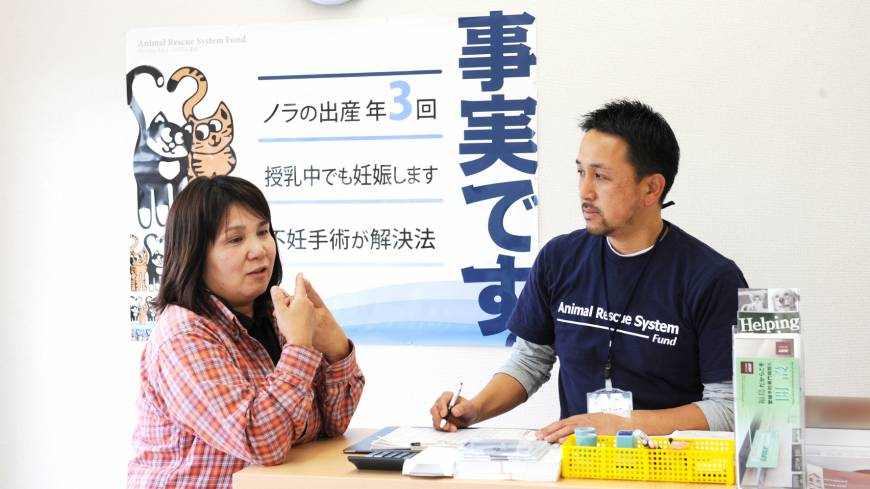 From Kobe to Fukushima: Hiro  Yamasaki of the Animal Rescue System Fund speaks to a pet owner at the Fukushima Spay Clinic in Shirakawa, Fukushima.
