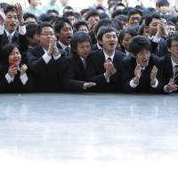 A man's world: Vocational school students cheer during a rally to kick off their job-hunting quest in Tokyo in February. 'Closing the gap between male and female employment would boost Japan's GDP by as much as 16 percent,' said this year's Global Gender Gap report, which ranked Japan 105th out of 133 participating countries. | BLOOMBERG