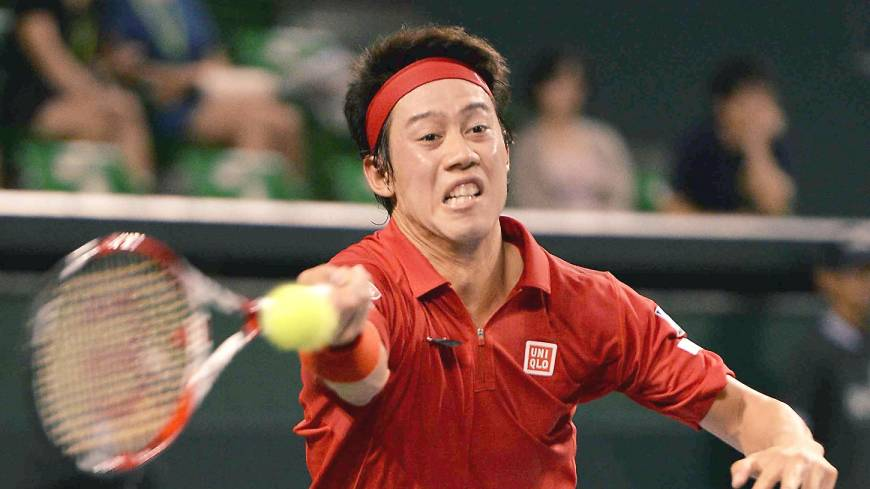 Kei Nishikori  plays a shot during Japan's Davis Cup World Group playoff against Colombia at Ariake Colosseum in September.