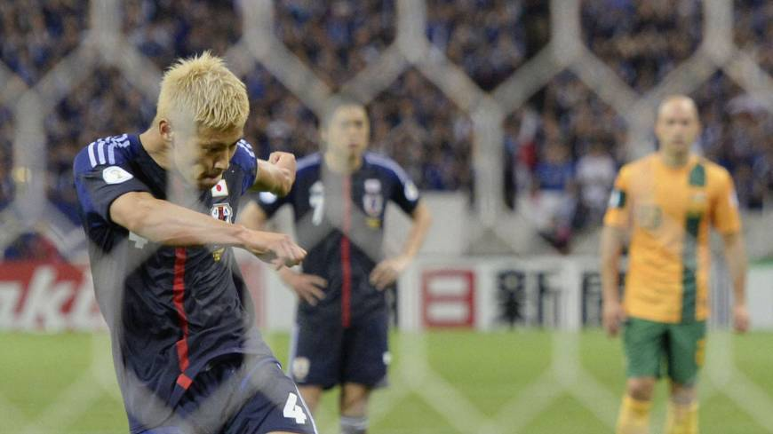 First past the post: Keisuke Honda  scores a penalty in injury time at Saitama Stadium in June to give Japan a 1-1 draw with Australia, making the Blue Samurai the first team to qualify for the 2014 World Cup.