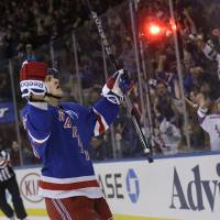 Are you impressed?: The Rangers' Carl Hagelin (left) celebrates after scoring against the Wild during the second period on Sunday in New York. The Rangers won 4-1. | AP