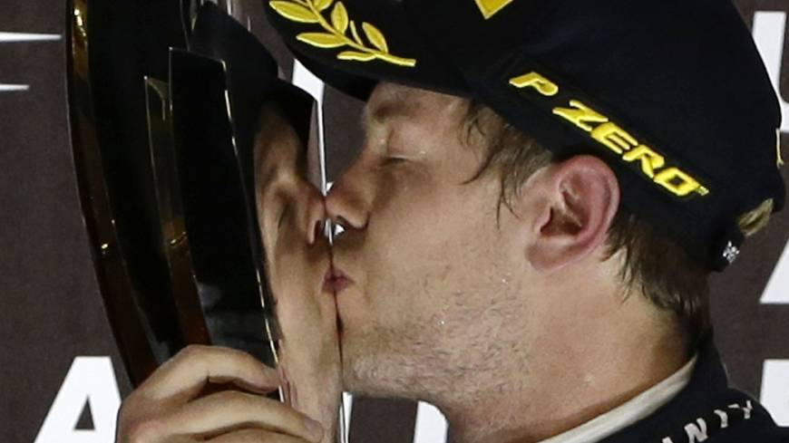 Formula One drivers probably wished there was something that could've kept Sebastian Vettel away, as they watched the German kiss the trophy after clinching a fourth straight F1 crown with a win in the Abu Dhabi Grand Prix.