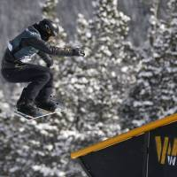 Easy does it: Shaun White slides off a rail during the U.S. Grand Prix slopestyle snowboarding finals on Sunday in Copper Mountain, Colorado. White finished third. | AP