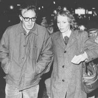 Happier times: Woody Allen and actress Mia Farrow stroll up New York's 8th Avenue in January 1984. | AP